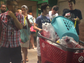 Students exiting Target with a full cart of essentials