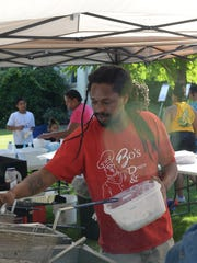 Tarrington Smith cooks for participants in a Juneteenth