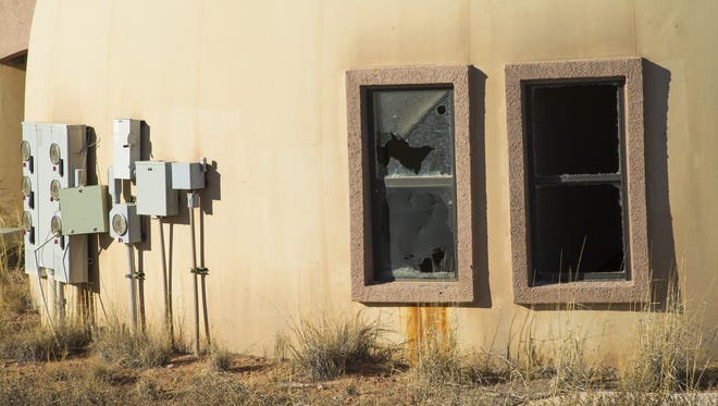 Signs of disuse are apparent at the Navajo Housing Authority's Tolani Lake, Ariz., project. Apartments have broken windows and other forms of vandalism.