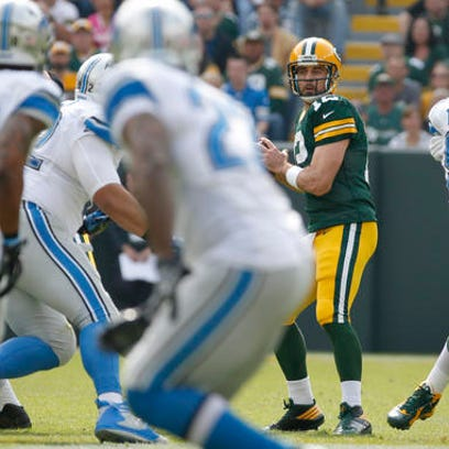 Green Bay Packers' Aaron Rodgers drops back to pass