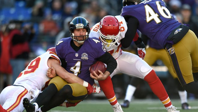 Baltimore Ravens punter Sam Koch (4) is tackled during a fake punt in Sunday's game against Kansas City. The Ravens lost, 34-14, dropping to 4-10 on the year.
