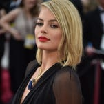 """Wolf of Wall Street"" star Margot Robbie brings back a touch of Hollywood Golden Age glamour with this classic coif, reminding of the great film noir screen siren Lizabeth Scott, who died late last month. Just beautiful."