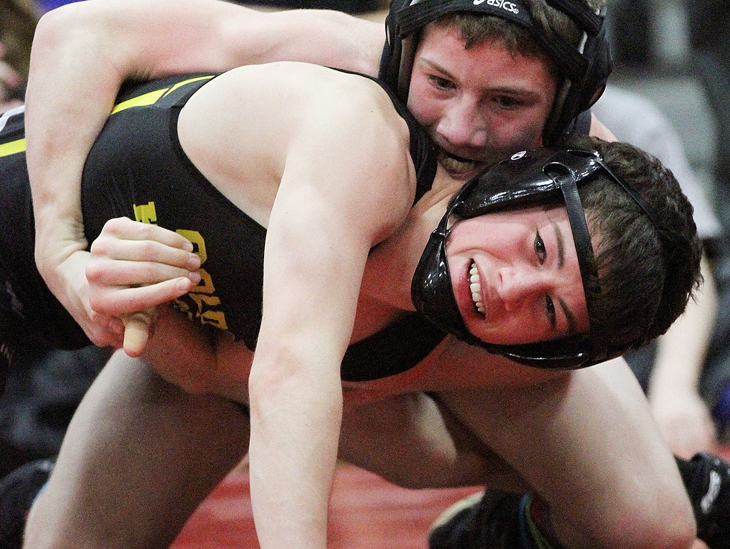 Northmor's 106-pounder Jake Neer (bottom) was a state qualifier last season and won 36 matches.