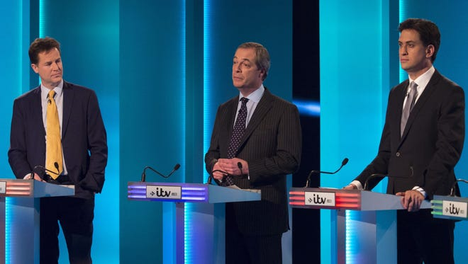 Left to right: Liberal Demorcrat leader Nick Clegg, UKIP's Nigel Farage and Labour leader Ed Miliband during the live television debate of the United Kingdom party leaders hosted by British TV station ITV.