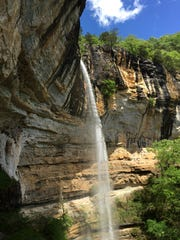 File photo shows Hemmed-in-hollow waterfall, where