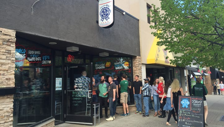Patrons wait outside a packed Tin Can in East Lansing