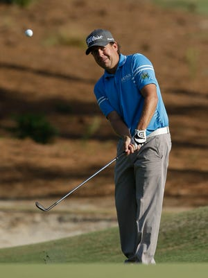 Erik Compton chips on the 16th hole during the third round of the 2014 U.S. Open golf tournament.