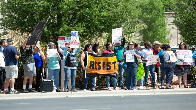 Protestors gather at the corner of East University Avenue and South Valley Drive on Wednesday, April 11, 2018, at the Ramada Palms where Attorney General Jeff Sessions spoke during the Texas Border Sheriff's Coalition Annual Spring Meeting with the Southwestern Border Sheriff's Coalition.