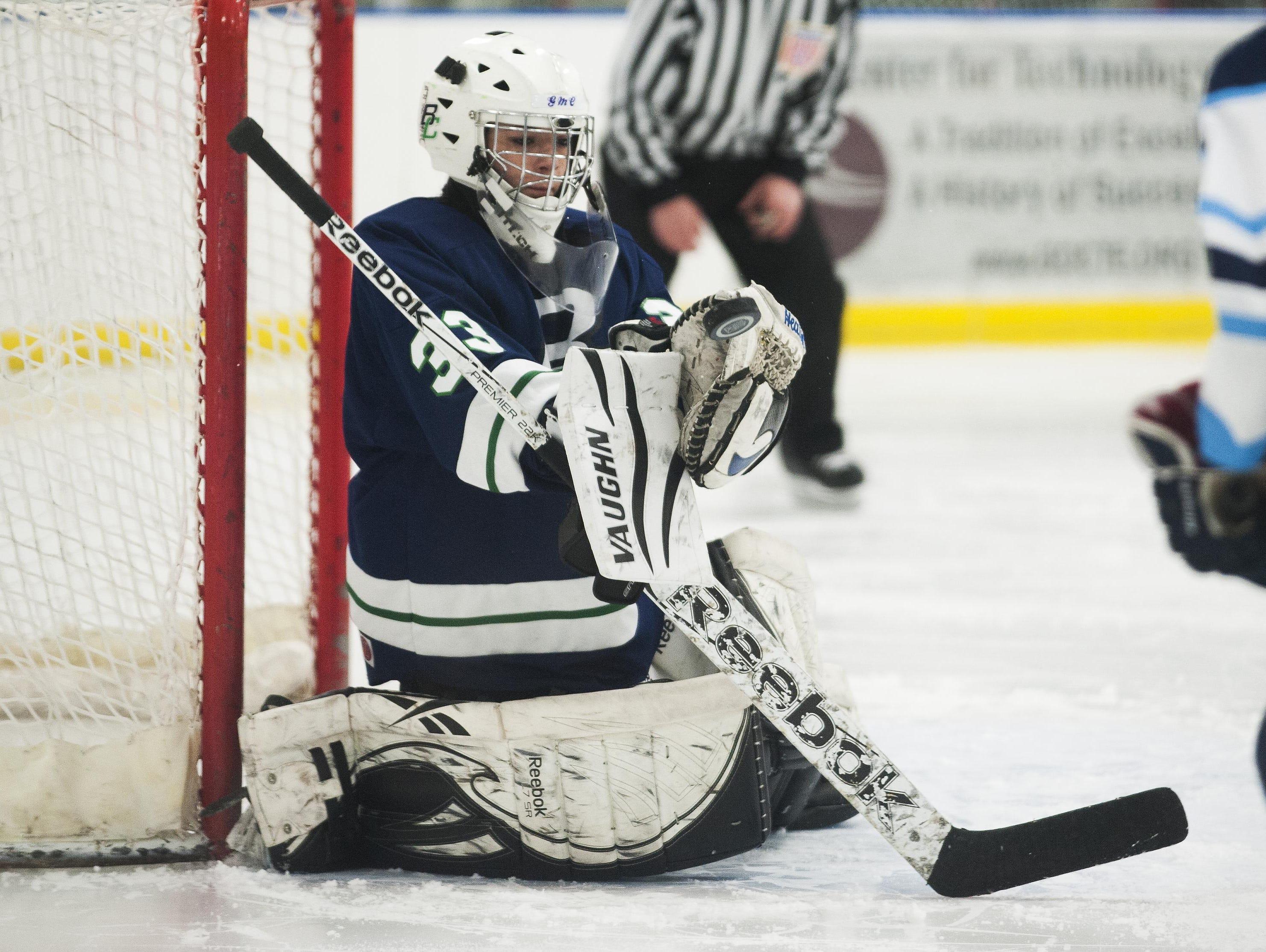 Burlington/Colchester goalie Jenna Blondin (33) makes a save during a girl playoff hockey game last season.