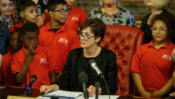 Iowa Gov. Kim Reynolds signs into law SF 359, the fetal