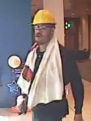 This surveillance image was taken May 13, when the bank robber wore construction gear to rob a PNC Bank branch in the 300 block of Delaware Ave., city police say.