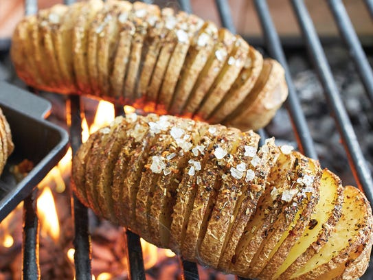Mandolined potatoes cook faster on the grill. Hasselback