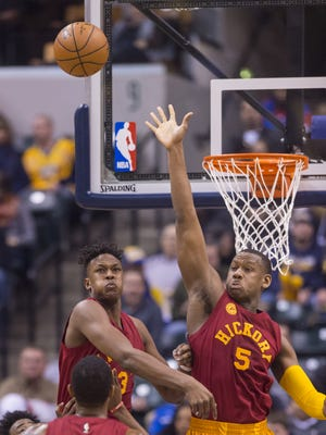 Indiana Pacers forward Myles Turner (33), left, and forward Lavoy Allen (5) try to block a shot during the first half of an NBA basketball game, Tuesday, Jan. 26, 2016, at Bankers Life Fieldhouse in Indianapolis.