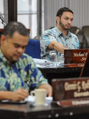 Sen. Michael San Nicolas decides to pass on his vote during roll call on the 2017 fiscal budget bill at the Guam Legislature in Hagåtña on Monday, Aug. 29. He was the lone vote against the measure.