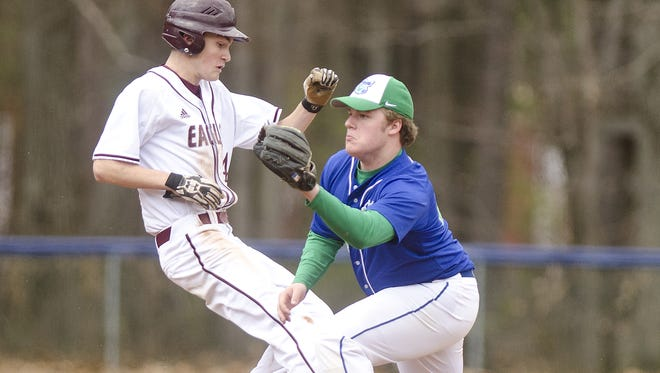 Mount Abraham's Saywer Kamman, left, hurries to second base before Colchester's Jared Antoniak can apply the tag during a game earlier this season.