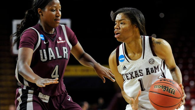 UALR Trojans forward Kiera Clark (4) defends Texas A&M Aggies guard/forward Courtney Williams (1) during the first half in the first round of the women's NCAA Tournament at Wells Fargo Arena on March 21 in Tempe.