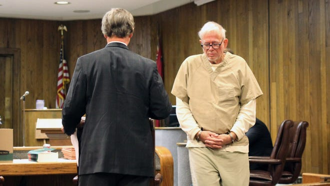 Dr. Arnold Smith, wearing shackles and a tan county jail jumpsuit, arrives in the courtroom at the Leflore County Courthouse Wednesday, Oct. 8, 2014 in Greenwood, Miss., for a hearing on his mental competency. Judge Breland Hilburn ruled that Smith, a Greenwood oncologist and the alleged instigator of a botched murder-for-hire plot to kill attorney Lee Abraham, was mentally unfit for trial and ordered proceedings begun to commit Smith to a mental institution.  (AP Photo/The Greenwood Commonwealth, Bryn Stole)