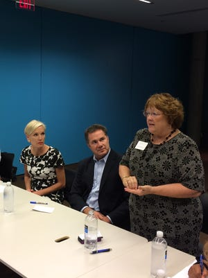 Planned Parenthood Action Fund President Cecile Richards and U.S. Rep. Bruce Braley are introduced by Iowa state Rep. Marti Anderson at a forum Friday at the Des Moines Public Library.