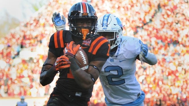 Virginia Tech's Isaiah Ford hauls in a pass against North Carolina earlier this year.