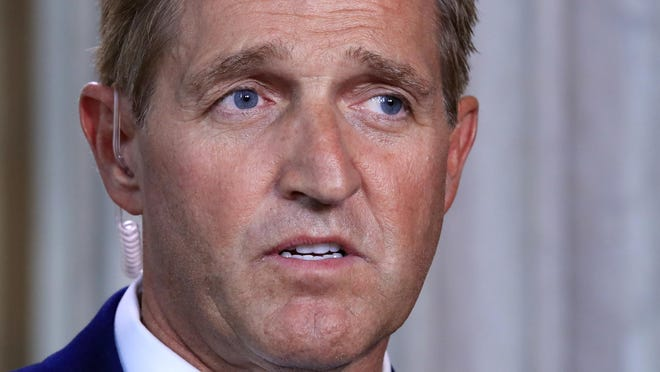 """Sen. Jeff Flake, R-Ariz., speaks during a television interview Capitol Hill in Washington, Tuesday, Oct. 24, 2017. Sen. Flake, an Arizona Republican, announced he would not run for re-election in 2018, condemning in a speech aimed at President Donald Trump the """"flagrant disregard of truth and decency"""" that is undermining American democracy. (AP Photo/Manuel Balce Ceneta)"""