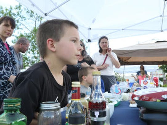 Ezra Day, 7, waits patiently for fresh ice cream at