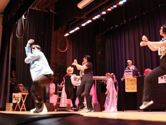 "Erik Stratman, left, performs ""Gangnam Style"" by Psy"