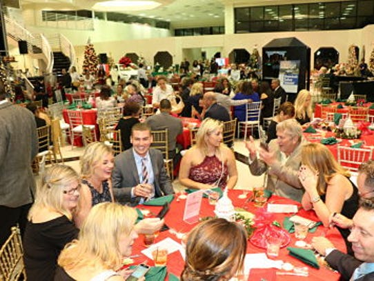 Guests at CASTLE's Holiday Magic Gala enjoy each other's
