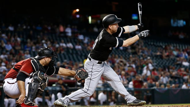 Chicago White Sox's Todd Frazier, right, strikes out as Arizona Diamondbacks' Chris Iannetta, left, catches the baseball during the first inning of a baseball game Wednesday, May 24, 2017, in Phoenix. The Diamondbacks defeated the White Sox 8-6.