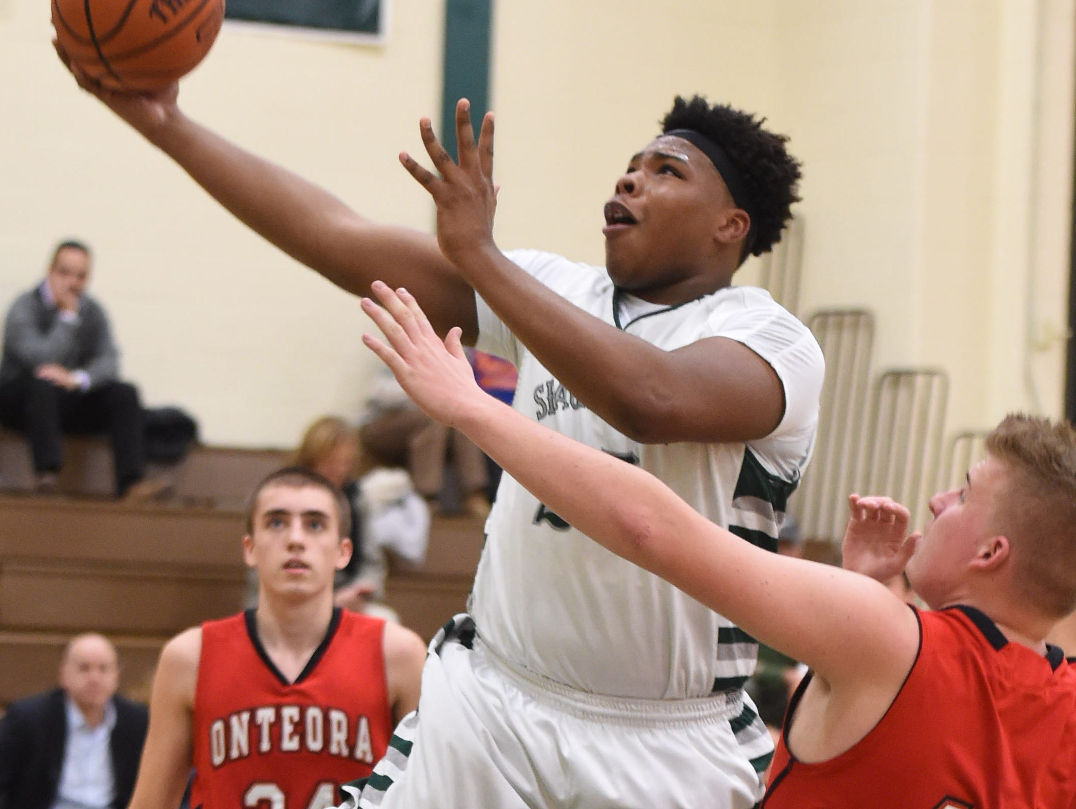 Spackenkill's Kyiev Bennermon goes for a layup past Onteora's, from left, Matthew Vines, and Nicholas Fulford during Thursday's game at Spackenkill.