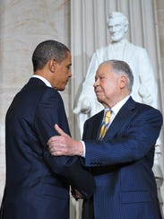 Former senator Edward William Brooke shakes hands witih