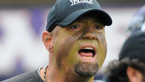 Ben Norton in full camouflage face paint at NSU's 2013 Military Appreciation Day game.