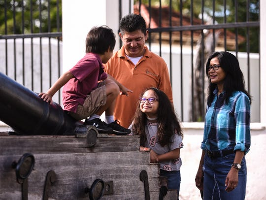 Maria Hope Diaz, 11, center, and her family during