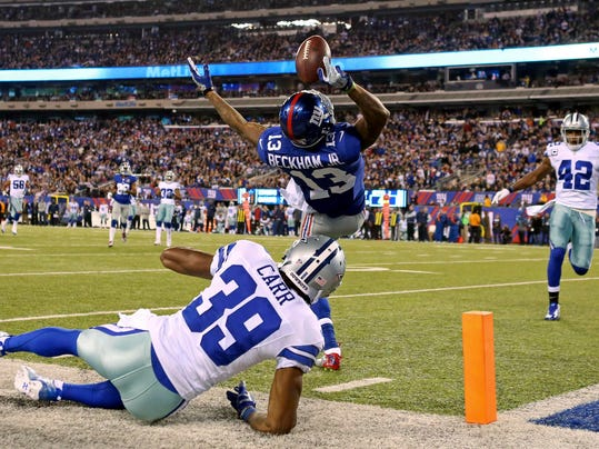 New York Giants wide receiver Beckham catches a touchdown pass over Dallas Cowboys cornerback Carr during their NFL football game in East Rutherford, New Jersey