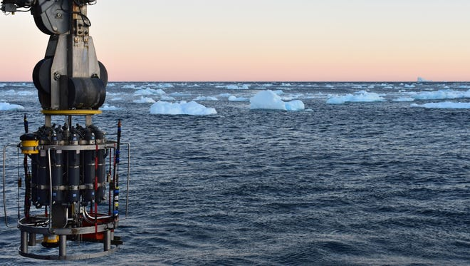 A probe which collects water samples and measures temperature, salinity and pressure is prepared for deployment on the continental shelf of Greenland.