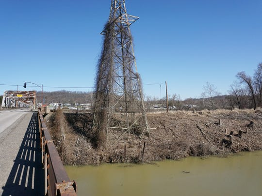 Trees have been removed from the banks for the former power plant canal in Philo to make way for construction related to a news bridge over the Muskingum River.