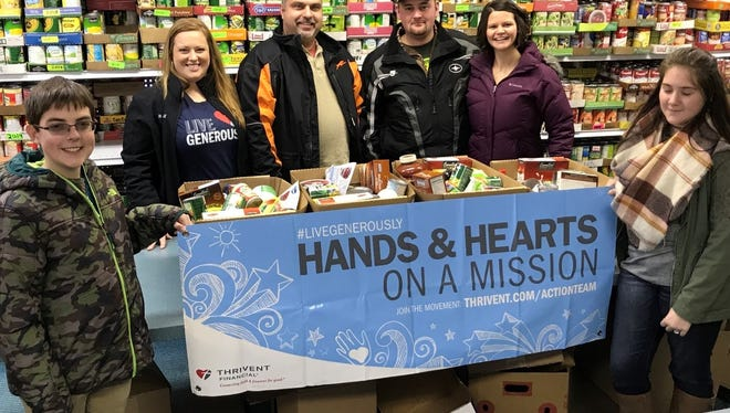 The Vanevenhoven family and Thrivent Financial supported Fond du Lac organizations this holiday season, including the Humane Society, Toys for Tots and Fondy Food Pantry. Pictured are, from left: Brady Ramthun, Mellissa Schmackle, Bob Ramthun, Chuck Vanevenhoven, Kimberly Vanevenhoven and Madelyn Bauer; not pictured: Ann Johnson, Arne Johnson and Sydney Vanevenhoven.