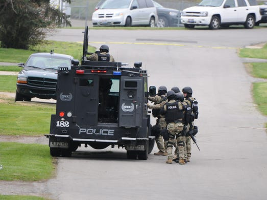 April 27, 2015Police try and coax a man out of his
