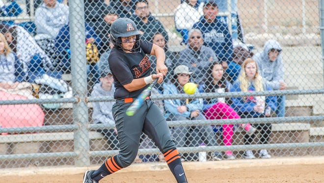Aztec's Kylie Brown hits a home run against Piedra Vista on April 8 at the Farmington Sports Complex.