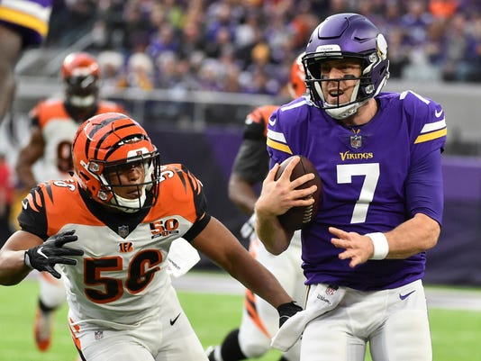 Minnesota Vikings quarterback Case Keenum (7) runs from Cincinnati Bengals linebacker Hardy Nickerson (56) during the first half of an NFL football game, Sunday, Dec. 17, 2017, in Minneapolis. (AP Photo/John Autey)