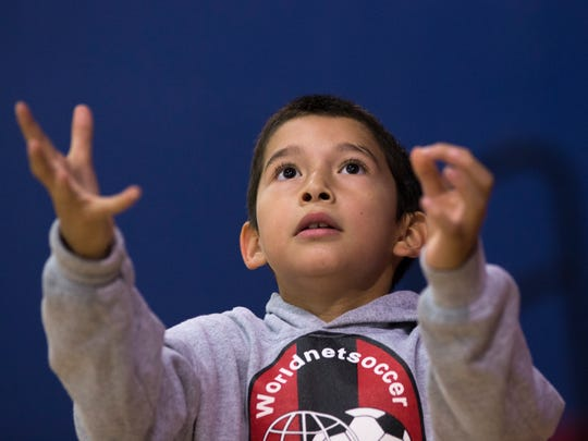 Alejandro Castillo, 8, plays catch in the club, which benefits from the annual golf tourney.