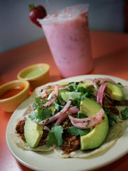 The tacos and a fruity agua fresca from Flautas y Paletería