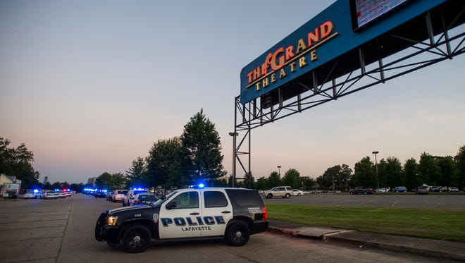 A Lafayette Police Department vehicle blocks an entrance July 23, 2016, at the Grand Theatre in Lafayette, La., following a shooting that killed two and wounded nine others.