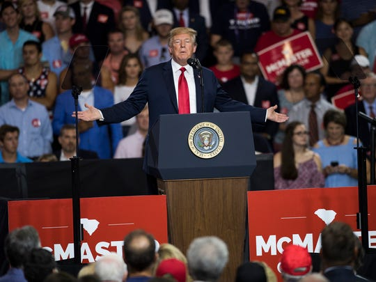 President Donald Trump speaks to the crowd as he campaigns for S.C. Governor Henry McMaster at Airport High School in Columbia on Monday June 25 2018.