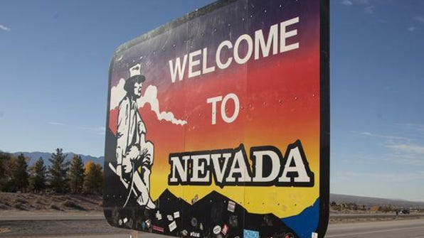 """""""Welcome to Nevada"""" greeting sign."""