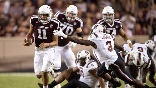 Texas A&M Aggies quarterback Kellen Mond (11) eludes South Carolina Gamecocks defensive back Chris Lammons (3) during the second half at Kyle Field. The Aggies defeat the Gamecocks 24-17.