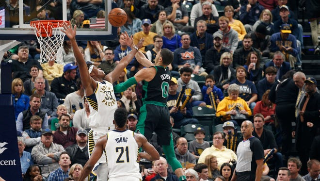 Nov 25, 2017; Indianapolis, IN, USA; Boston Celtics forward Jayson Tatum (0) takes a shot against Indiana Pacers center Myles Turner (33) in the first quarter at Bankers Life Fieldhouse. Mandatory Credit: Brian Spurlock-USA TODAY Sports