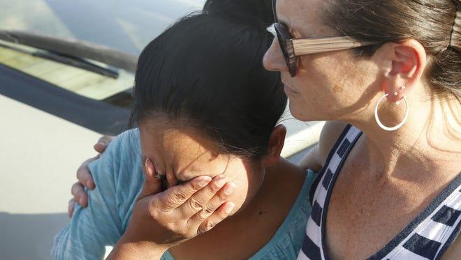 Juana Soch-tohom de Bulux cries as Jessica Berg hugs her outside CoreCivic Eloy Detention Center where she was released on July 6, 2018.