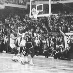 The Milwaukee Bucks' Kareem Abdul-Jabbar (right) drops the winning basket to defeat the Boston Celtics, 102-101, in Game 6 of the 1974 National Basketball Association championship at Boston Garden on May 10, 1974. The win tied the series at 3-3; the Celtics defeated the Bucks in Game 7 in Milwaukee two days later.