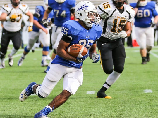Clay's Bilal Ally runs the ball as a sophomore during the 5A championship game. Ally has rushed for 2,727 yards and 35 touchdowns as a senior after missing his junior year with an ACL injury.