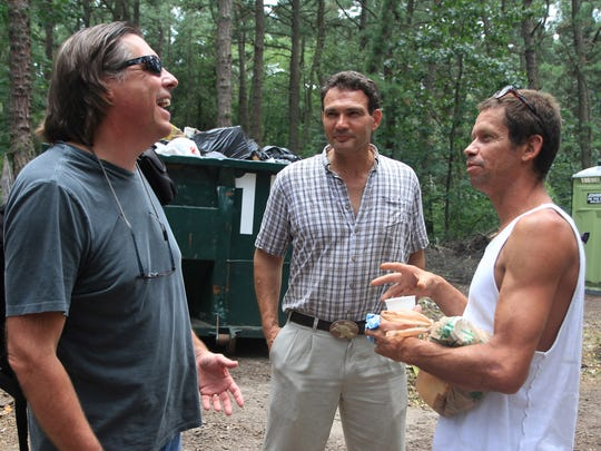 Jack Ballo (from left), who made a documentary about life in Tent City, talks with founder Steve Brigham, and resident Angelo Villanueva in 2013.